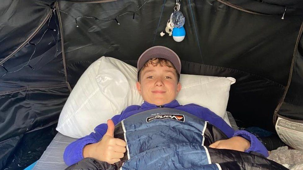 Max with Joe's sleeping bag 1.JPG