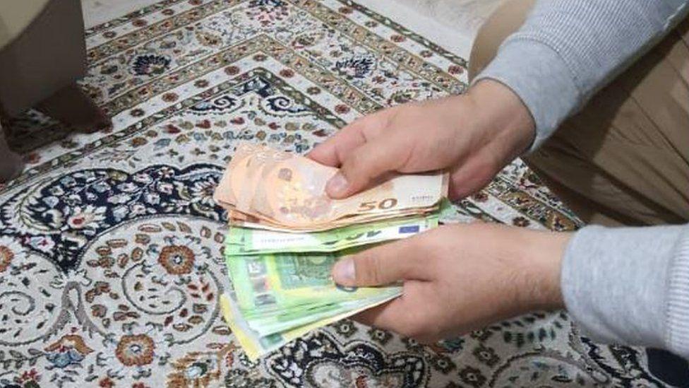 Noor counting cash