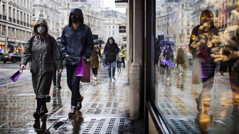 Shoppers in a wet London street