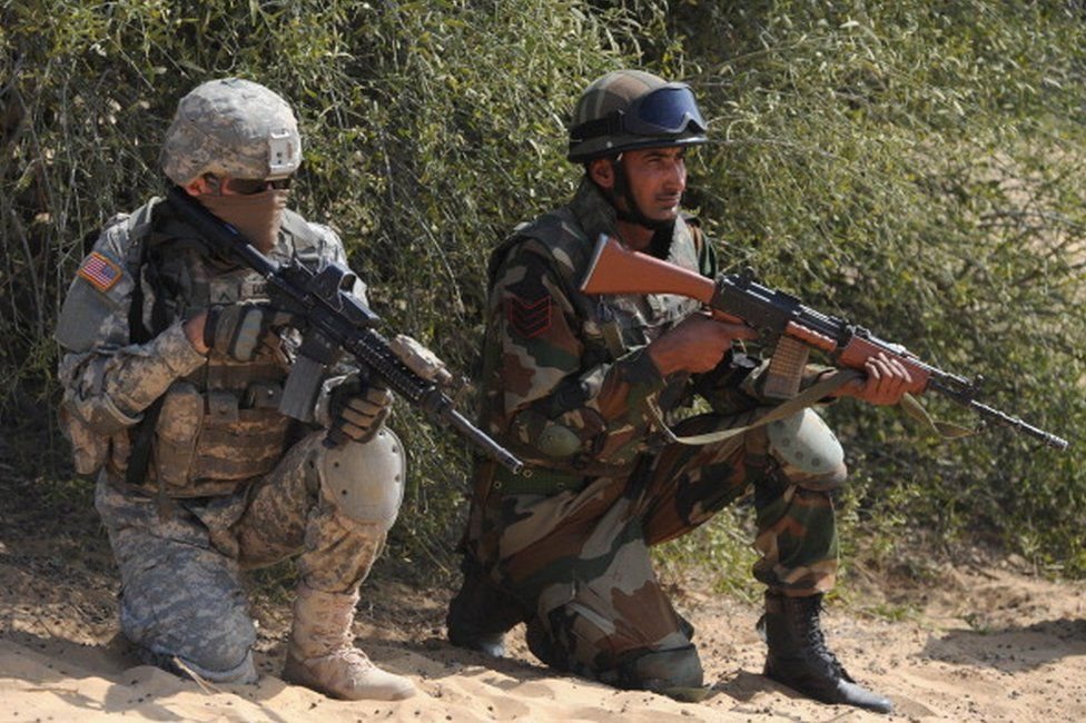 Indian and US soldiers participate in the Yudh Abhyas 2012 military exercise at Mahajan in Rajasthan sector, some 150 kms. from Bikaner, on March 13, 2012.