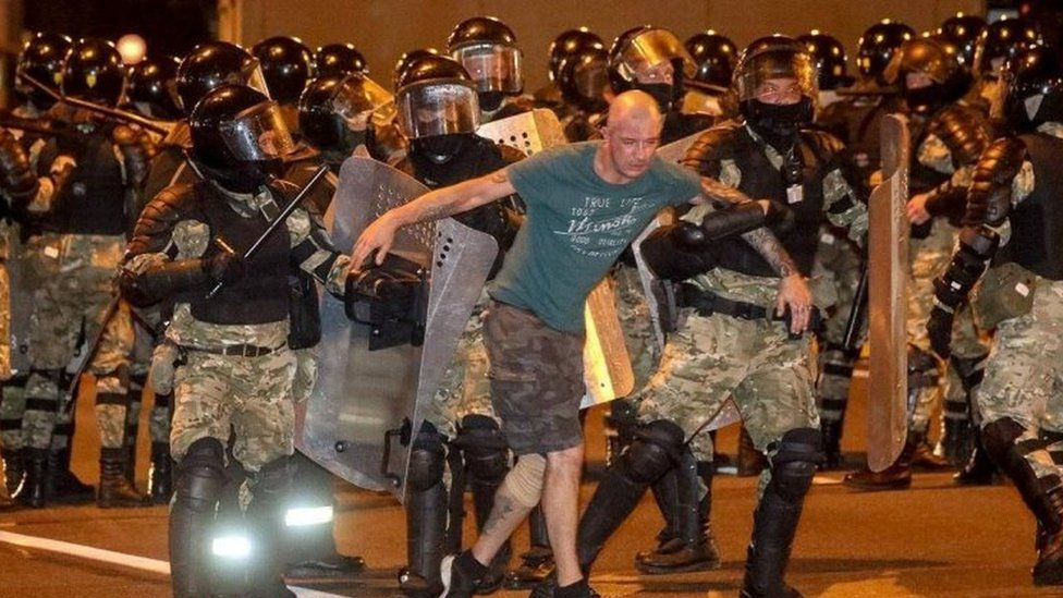Riot police detain a protester in Minsk, Belarus. Photo: 9 August 2020