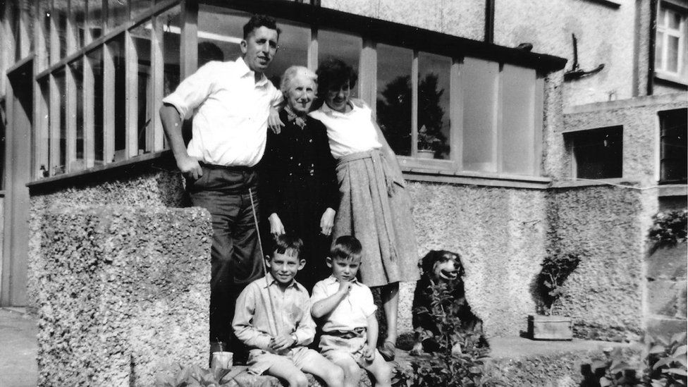 Kathleen's grandfather, great grandmother, great auntie, father, uncle and the family dog in Ireland