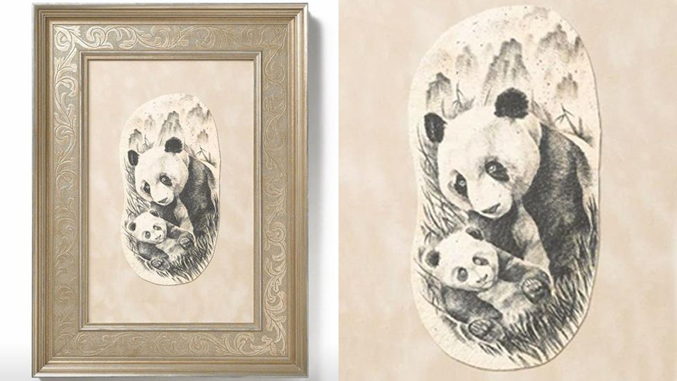 A framed preserved tattoo depicting two pandas