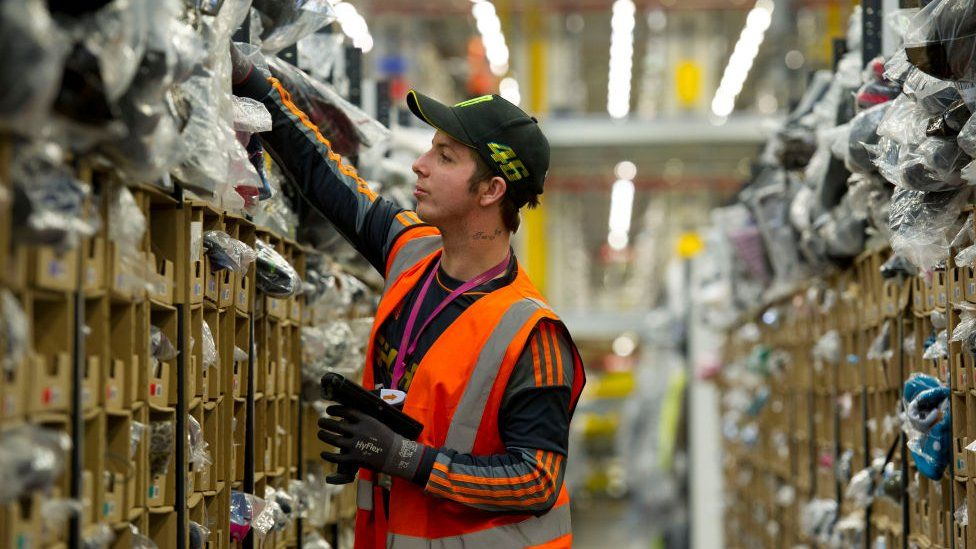 An Amazon worker at a warehouse in Swansea, Wales