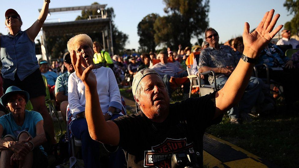 """Attendees sing during Franklin Graham's """"Decision America"""" California tour at the Stanislaus County Fairgrounds on May 29, 2018 in Turlock, California."""