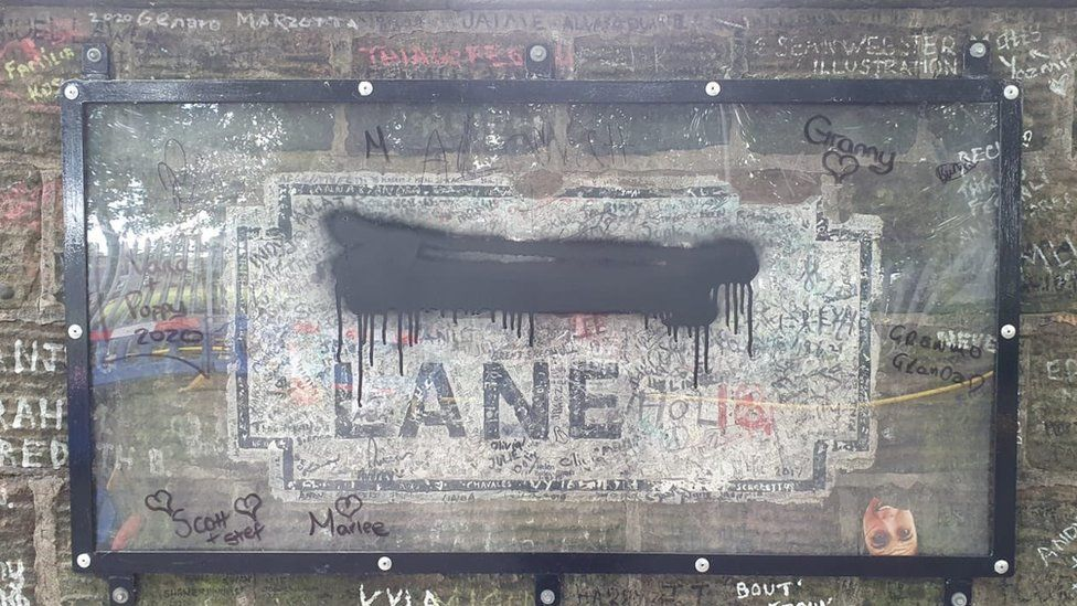 Defaced Penny Lane sign