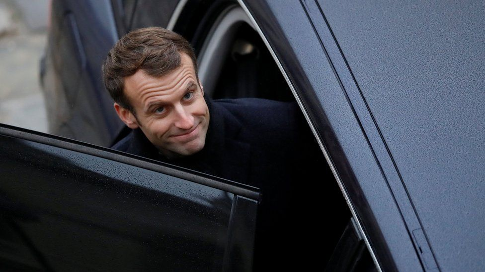 """French President Emmanuel Macron leaves after attending a """"prise d""""armes"""" military ceremony at the Invalides in Paris, France, November 26, 2018"""
