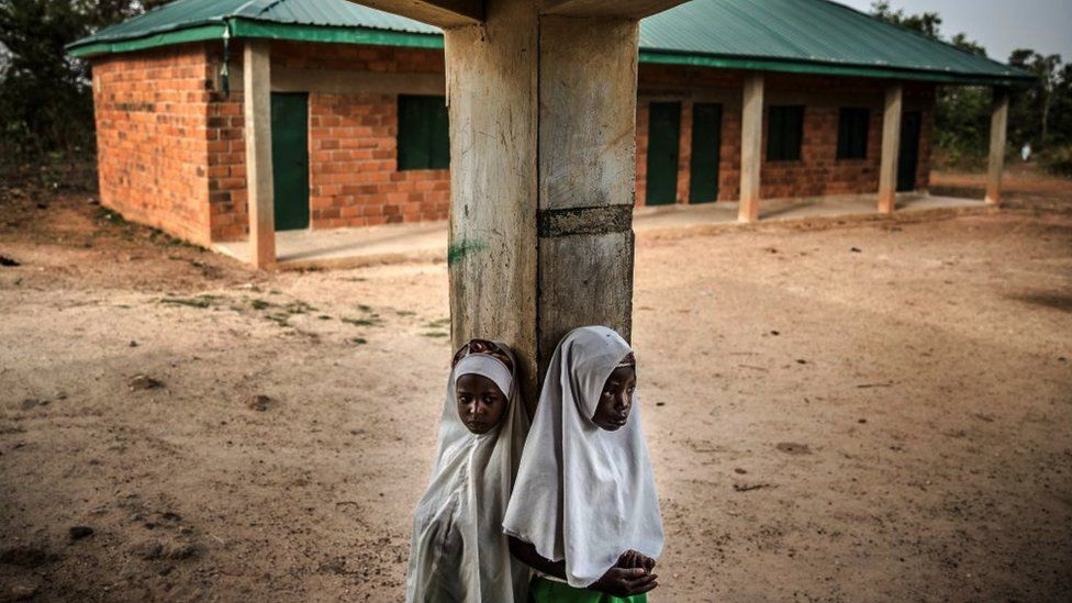 Two Fulani girls at an empty school playground.