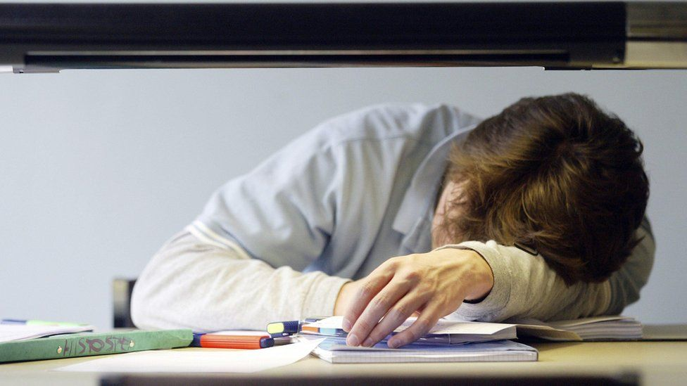 student sleeping on a desk