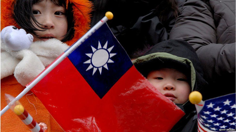 A child holds the ROC flag during a parade in DC's Chinatown.