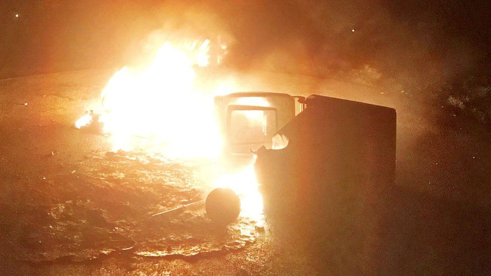 A bin set on fire in the north Belfast area, put out by the PSNI