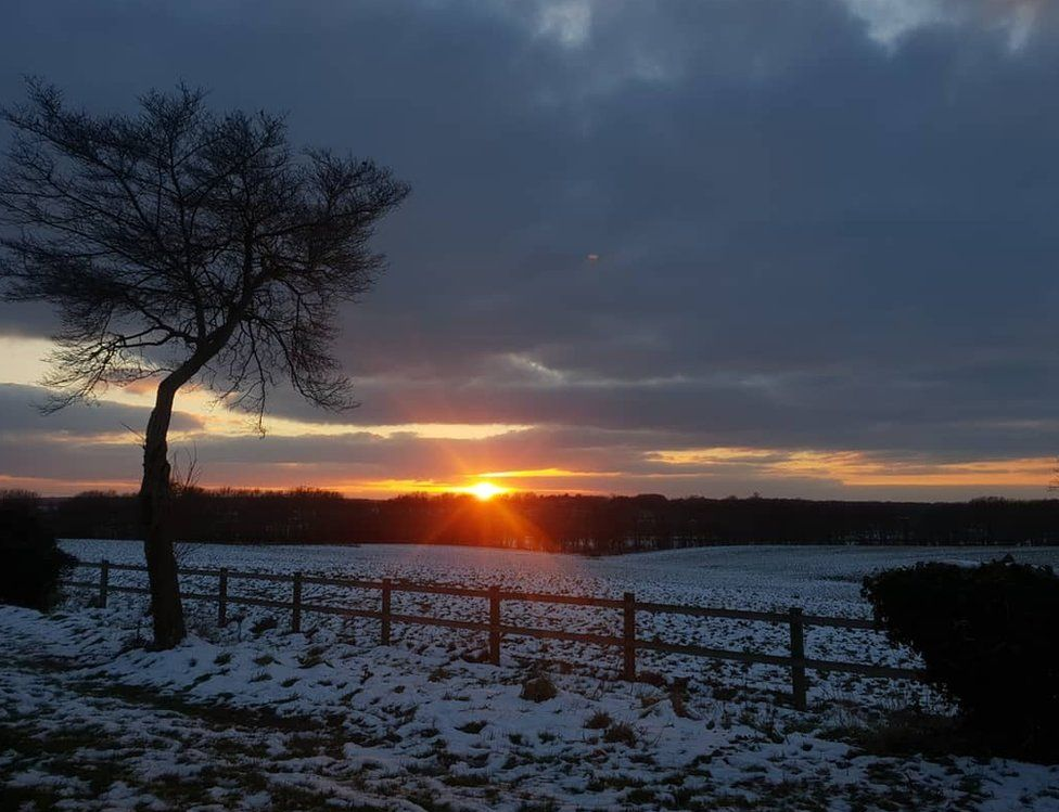 Sunset over a snowy field