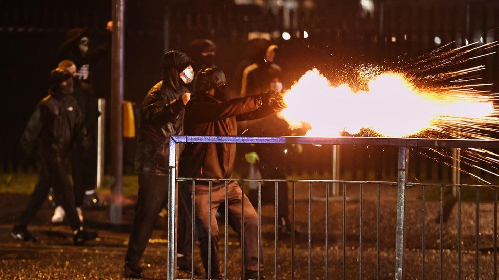 youths fire fireworks at the PSNI on the Springfield road, during further unrest in Belfast.