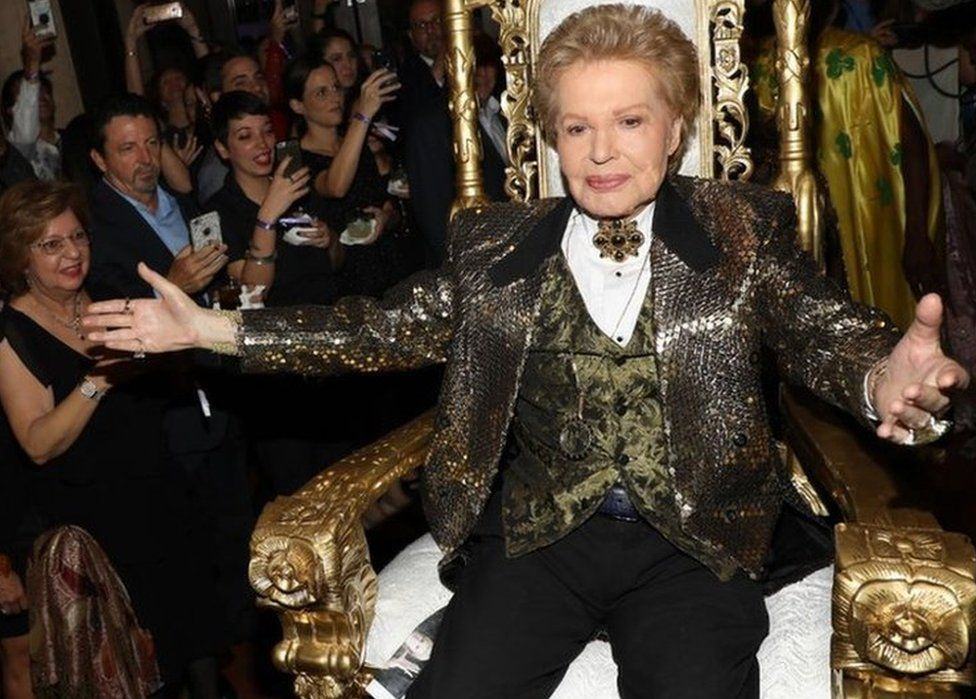 """Walter Mercado is seen at the opening of """"Mucho, Mucho Amor: 50 Years of Walter Mercado"""" at HistoryMiami Museum on August 1, 2019"""