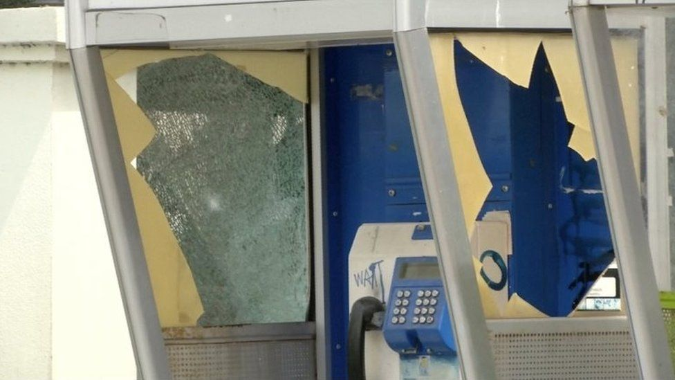 A damaged public telephone booth is seen at the site of a bomb blast in Hua Hin, south of Bangkok, Thailand
