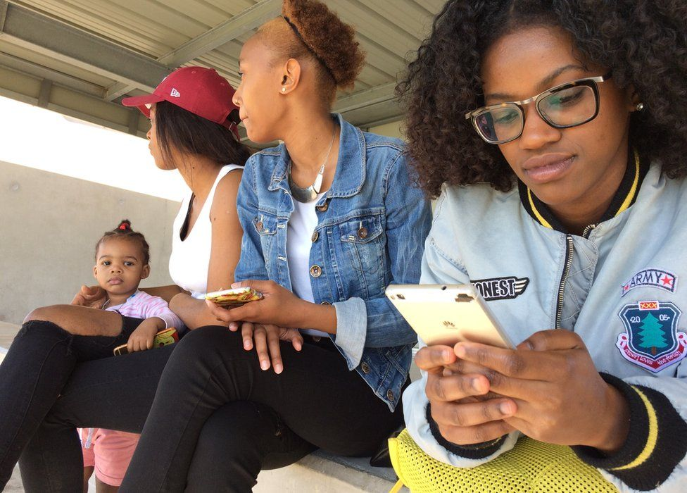 (from right) Sarah Mmadi, Razia Mohamed Zaki, Delphine Soumalia and little Delyha at a football match in La Busserine, 9 April