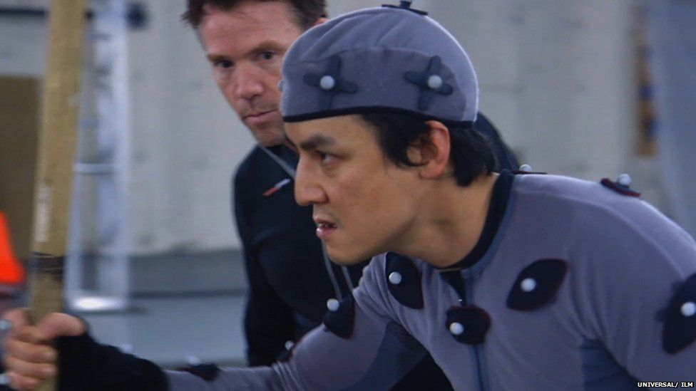 A suit using tracking markers and head mounted cameras are used to reinterpret the actors' facial performance