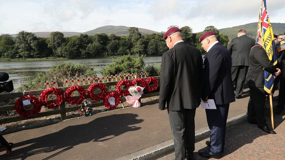 Veterans gathered at the roadside at Narrow Water
