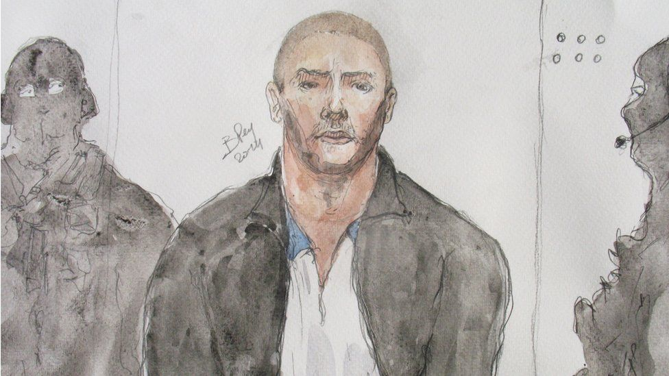This file court drawing made on June 26, 2014, shows Mehdi Nemmouche (C), the 29-year-old suspected gunman in a quadruple murder at the Brussels Jewish Museum, during a court hearing in Versailles, France