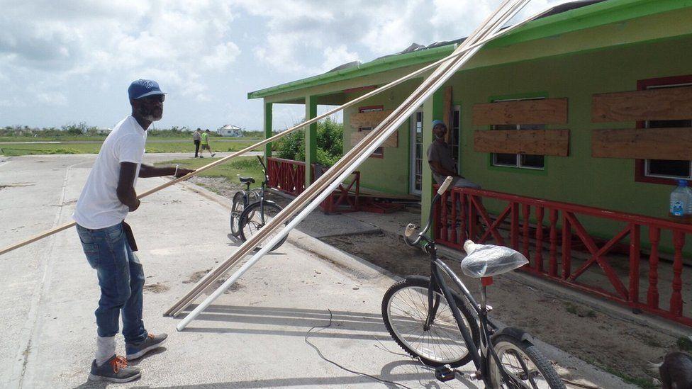 KK Payne helps fix the local bakery on Barbuda
