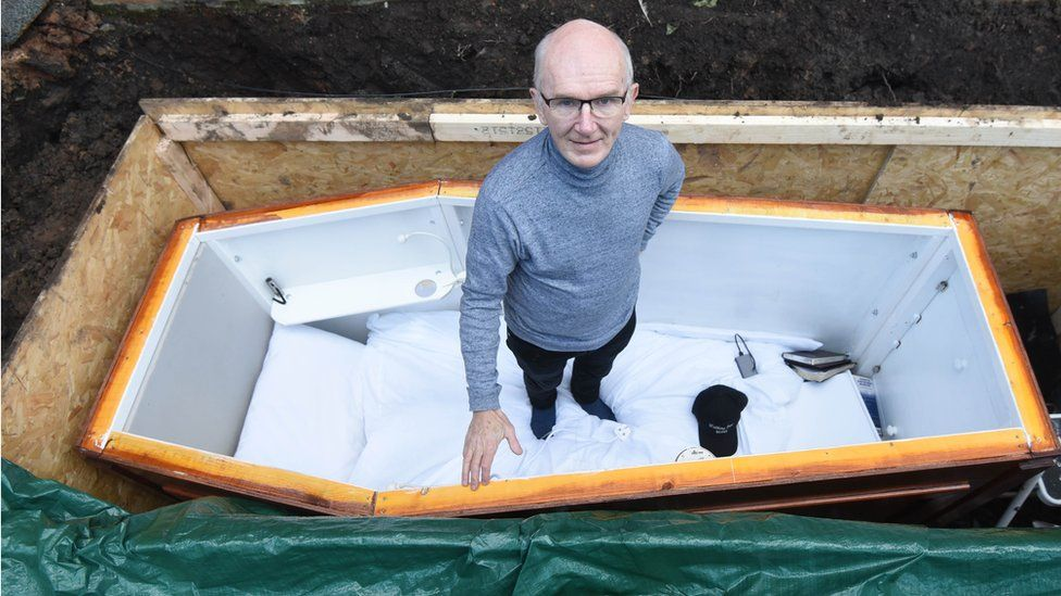 John Edwards posed in his coffin before he was buried alive