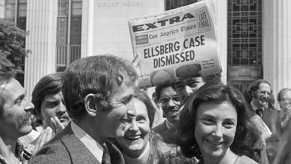 Daniel Ellsberg and wife walk from court after a federal judge dismissed the Pentagon Papers case