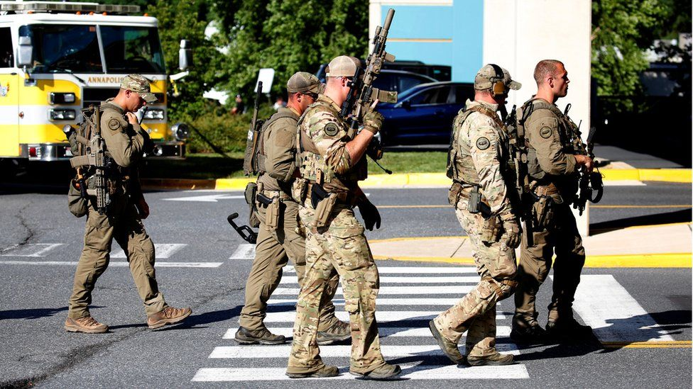 Tactical police gather at shooting scene outside the Capital Gazette newspaper in Annapolis, Maryland, 28 June 2018