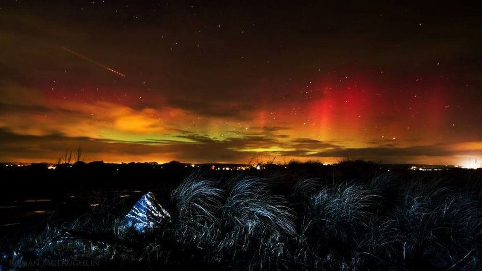 Fiery reds and oranges were seen over Ballynamona beach in County Cork, Ireland, as photographed by Ronan McLaughlin