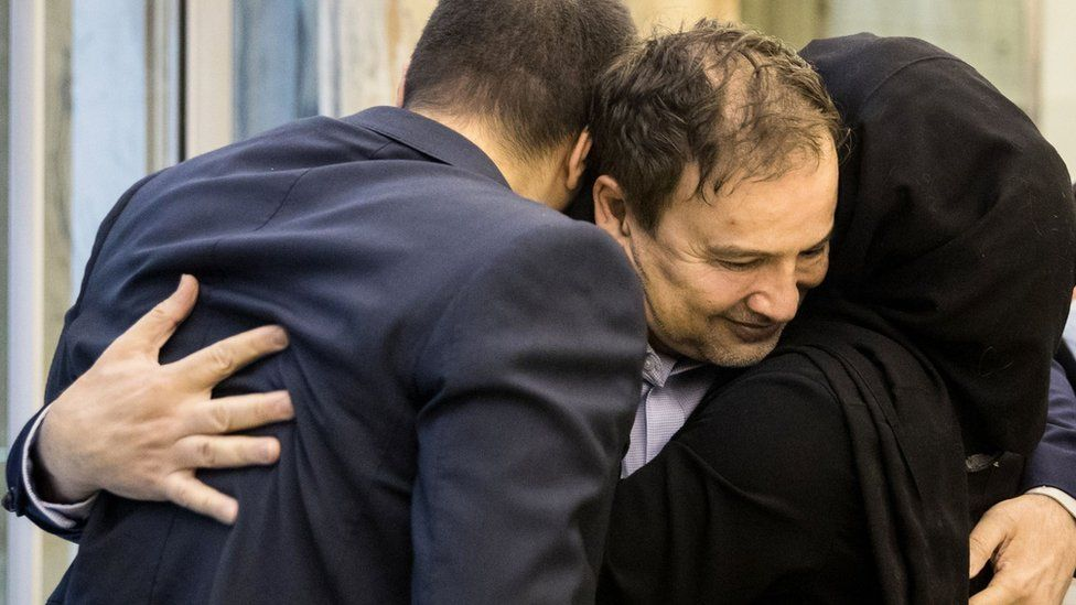 Iranian-American doctor Majid Taheri is hugged by family members on arrival at Tehran's airport on 8 June 2020