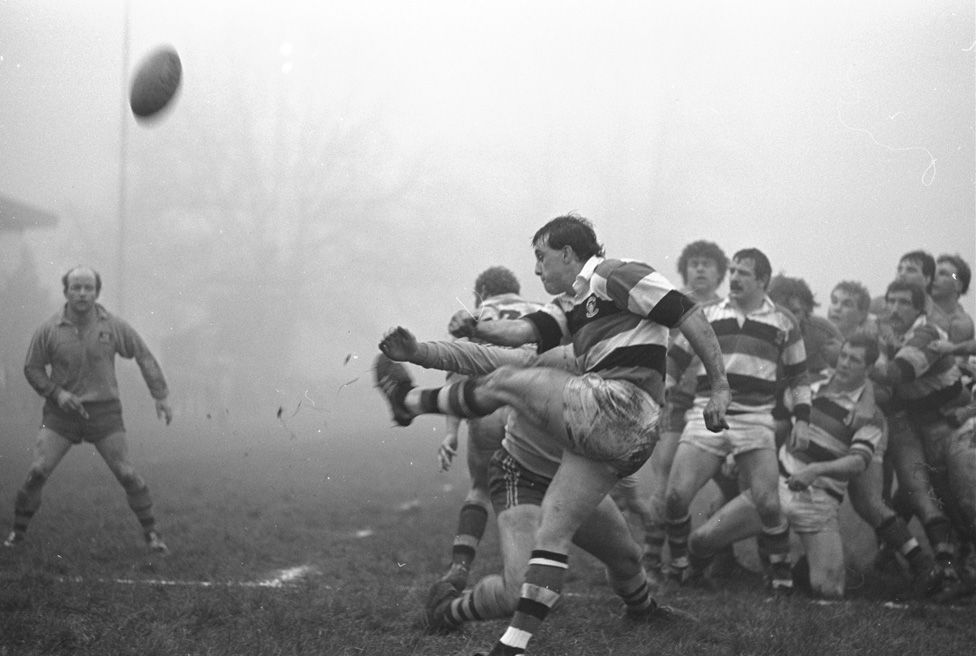 David Bishop kicks the ball for touch during a match against Australia in 1984