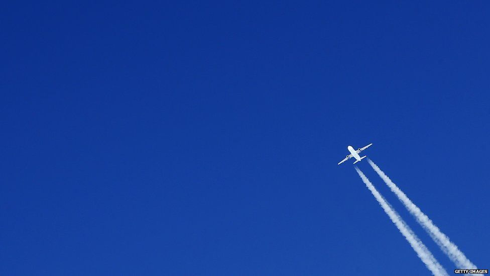 Plane with vapour trail