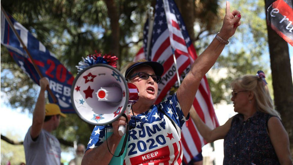 Supporters of Donald Trump outside the Hyatt Regency Hotel in Orlando