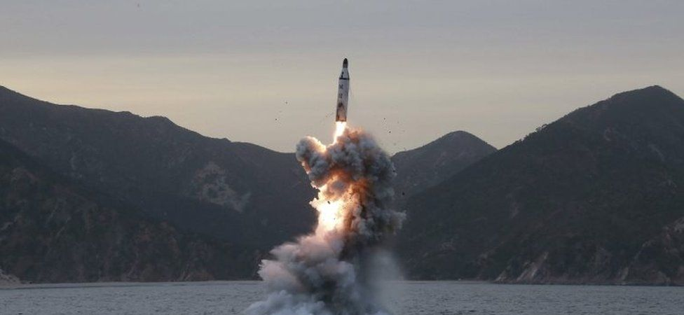 Undated image released by North Korea purporting to show a submarine missile launch