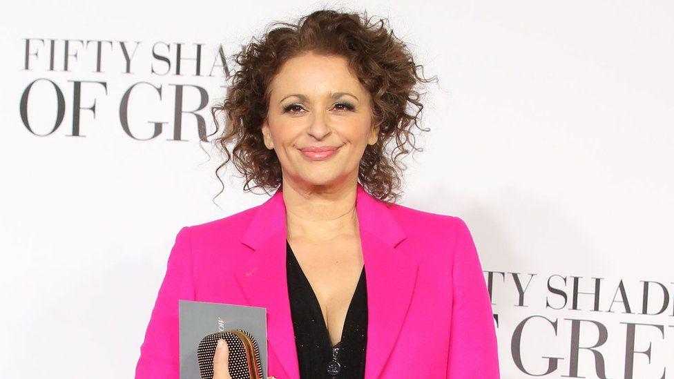 Nadia Sawalha poses on red carpet
