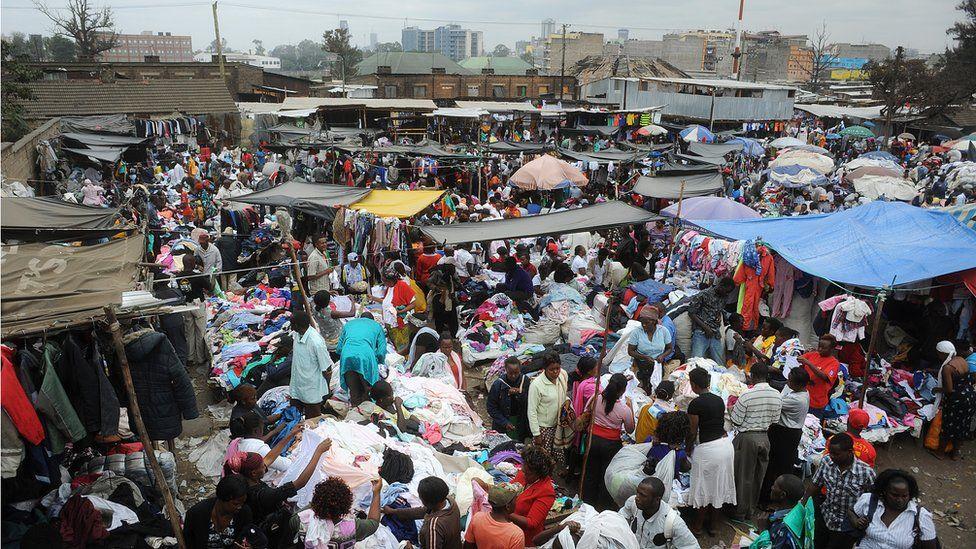 People walk around Gikomba Market, East Africa's biggest second-hand clothing market, on July 10, 2014 in Nairobi.