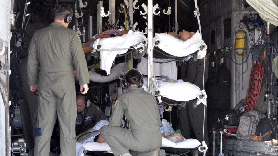 Patients piled into an emergency aircraft evacuation