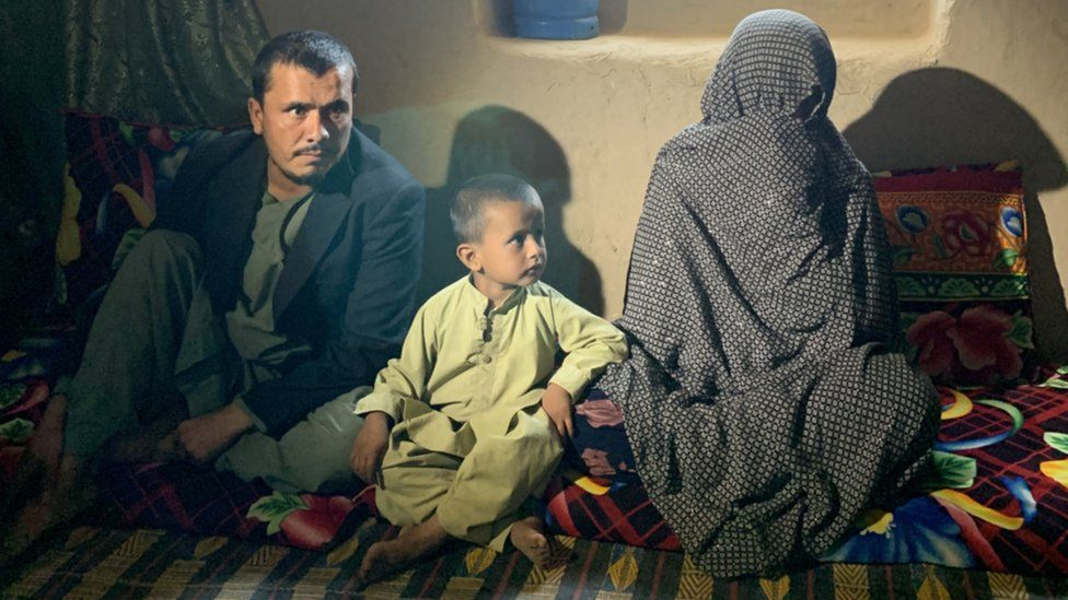Image shows Shamsullah, his son and his mother Goljuma