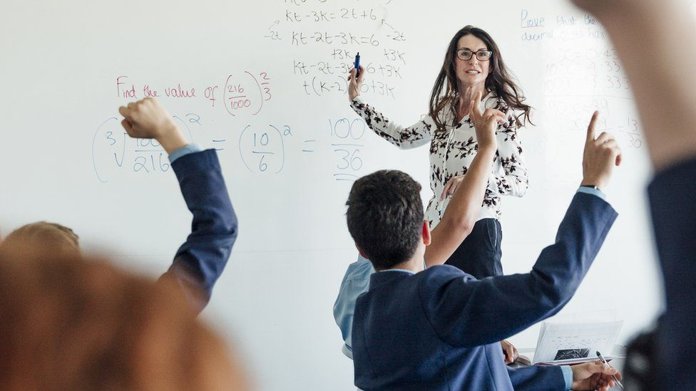 Stock picture of teacher in front of class
