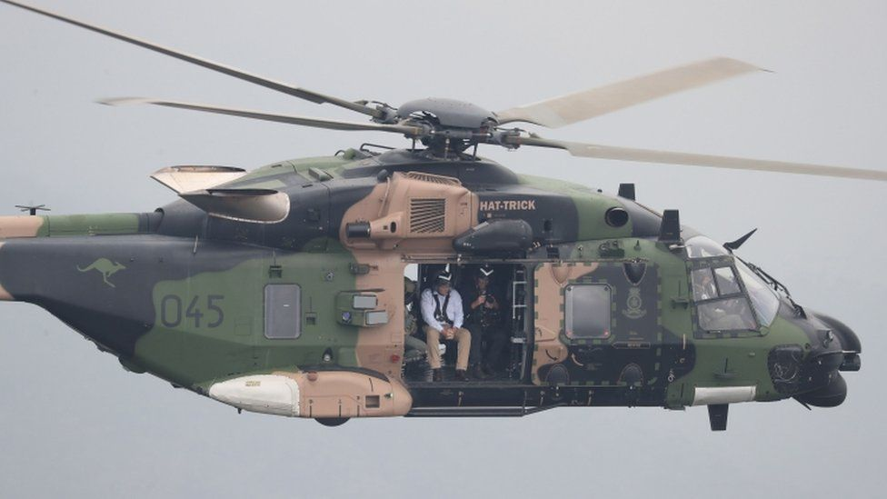 Australia's Prime Minister Scott Morrison, pictured here on 23 December, flying over bushfires in an Australian Defence Force helicopter in NSW