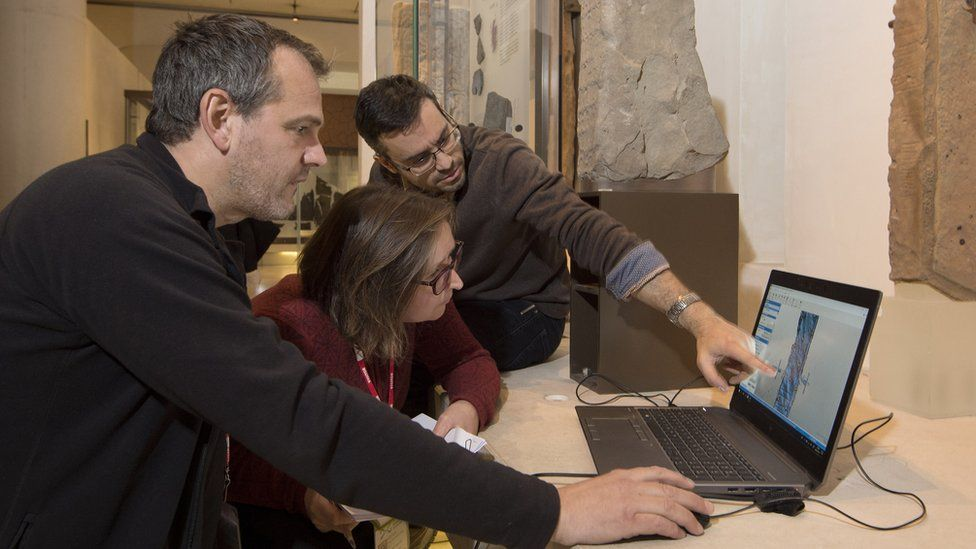 Researchers look at laptop