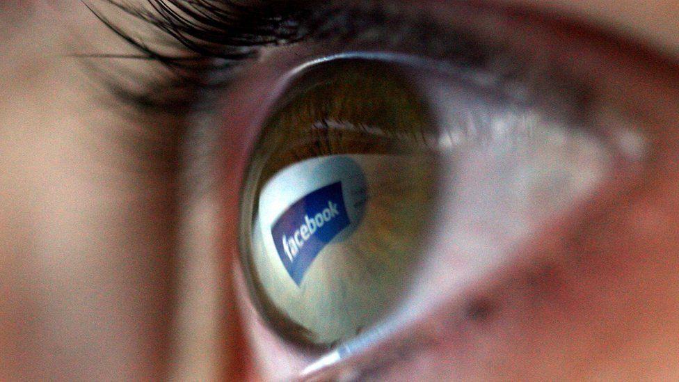 Facebook logo in an eye