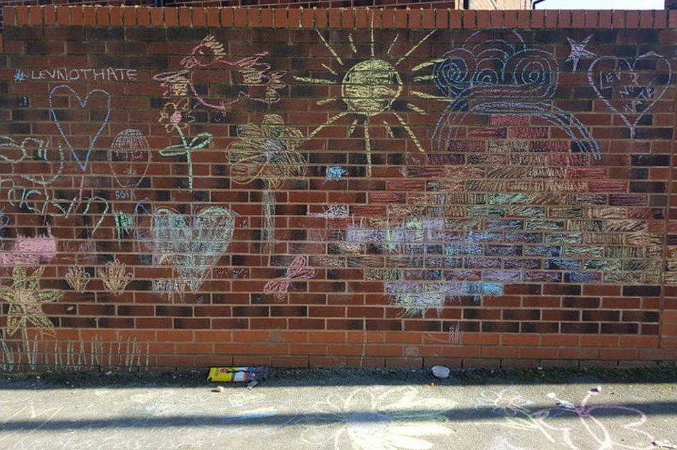 Chalk drawings over 'vile' graffiti