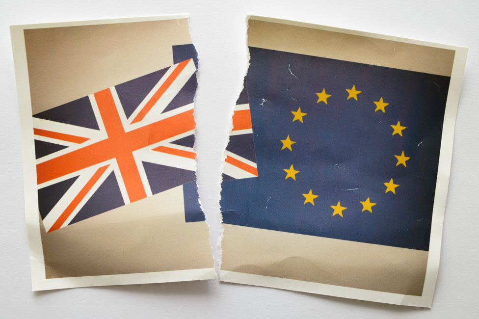 A torn photograph of the UK and EU flags