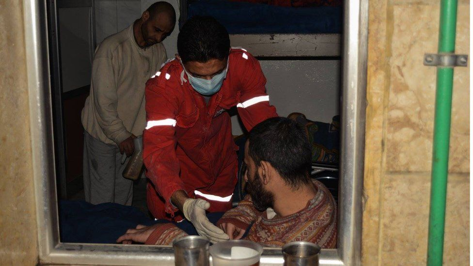 Red Crescent worker with disabled man, Aleppo Wednesday 7 December 2017