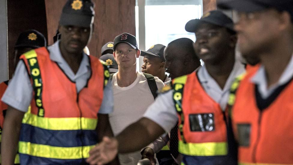 Former captain Steve Smith (C) of the Australian Cricket Team departs at O R Tambo International Airport after being caught cheating in the Sunfoil Test Series between Australia and South Africa, on March 28, 2018 in Johannesburg.