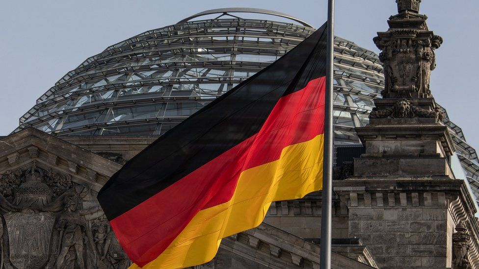 The German flag flies outside the Reichstag, the building which houses the Bundestag (the German lower house of parliament) on February 24, 2021 in Berlin