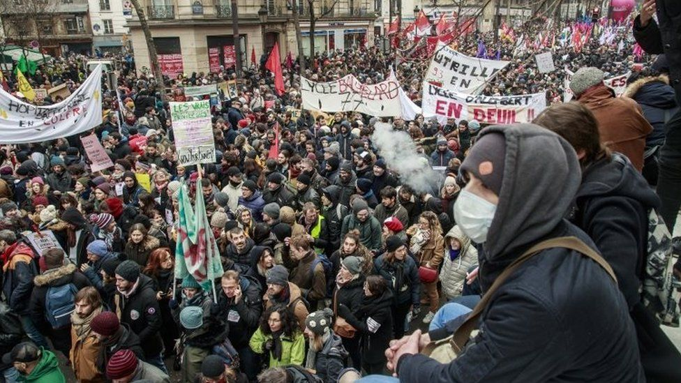 Public and private workers demonstrate and shout slogans during a demonstration against pension reforms in Paris on 5 December, 2019.