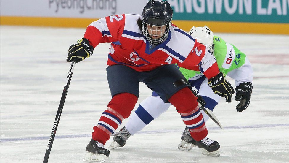 Jin Ok of North Korea's ice hockey team in action against Slovenia