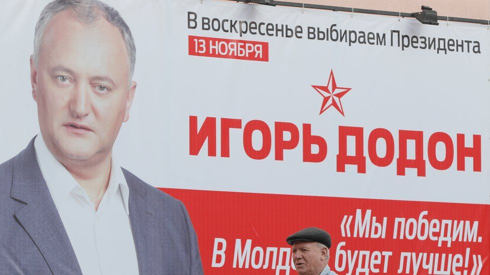"""An Igor Dodon's campaign poster with the slogan: """"We will win and it will be better in Moldova"""""""
