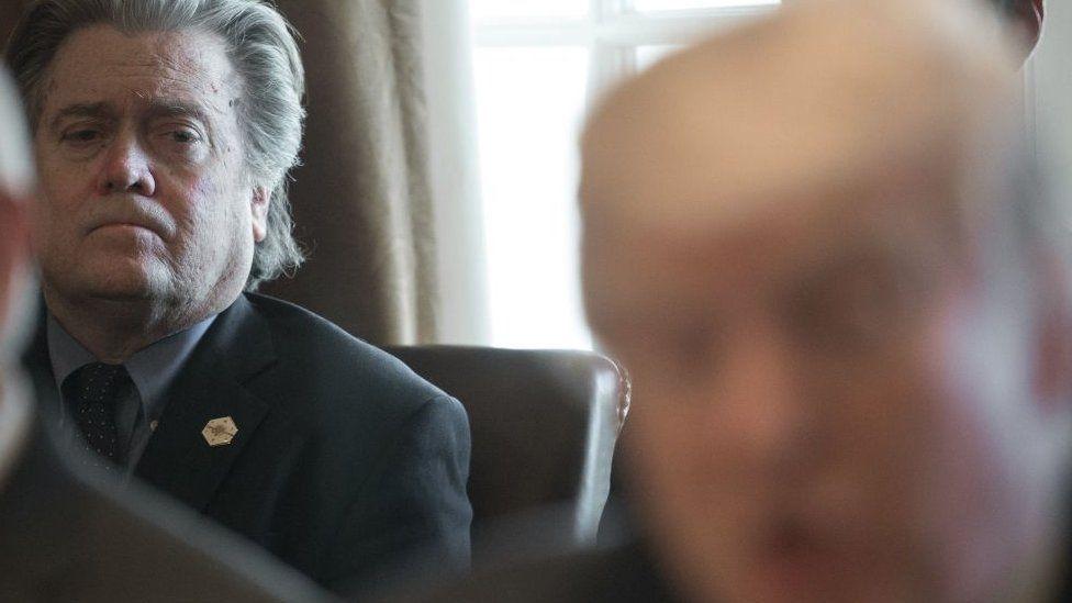 Steve Bannon watches as Donald Trump speaks